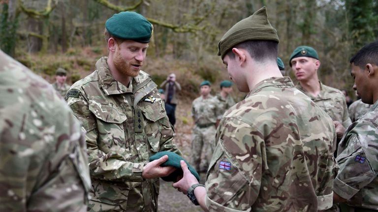 Prince Harry rewards Royal Marines with Green Berets as training ends